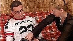A boy seduced by a hot mature woman giving him a blowjob