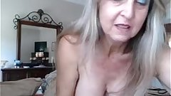 hot busty mature babe inserts anal plug and rubs pussy