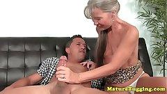 Smalltitted granny jerking cock
