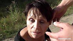 Short haired granny gets scurrilous fingering on a BM